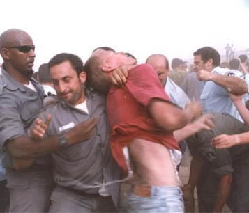 Police brutality during evacuation of settlers; well practised throat grip and fists